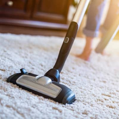 Photo of a vacuum being used on a rug