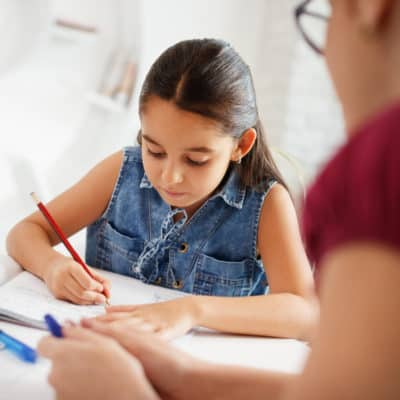 Photo of a young girl doing homework