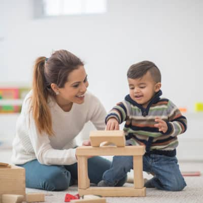 Photo of a young boy playing with blocks