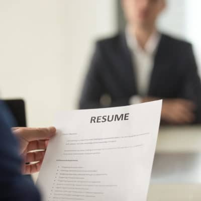 Photo of someone holding a resume