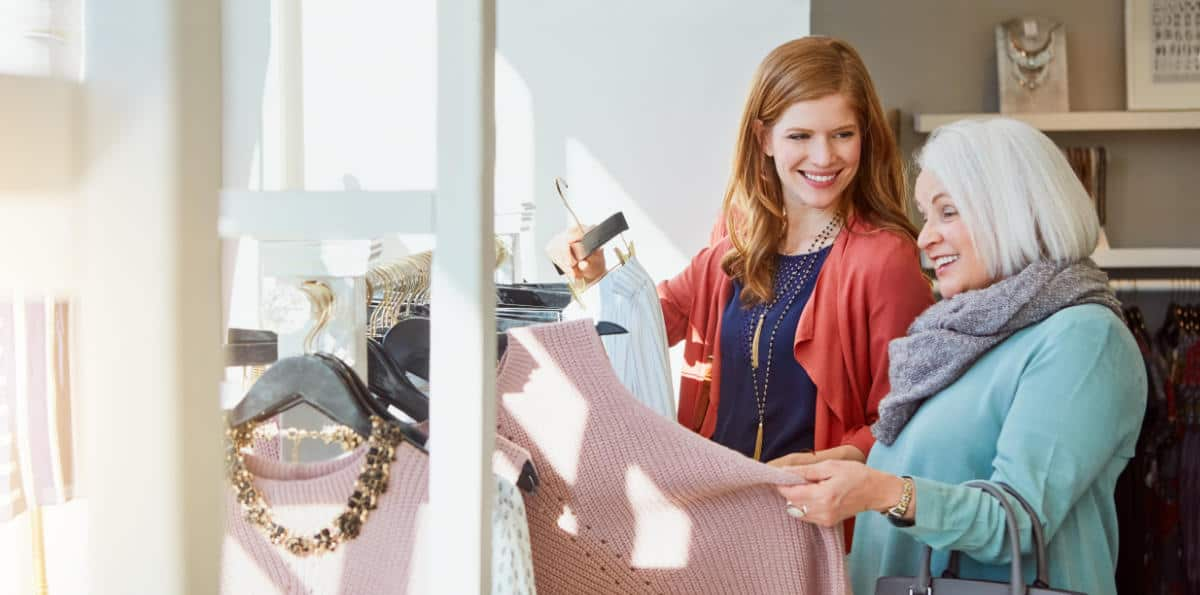 Photo of two ladies shopping for clothes